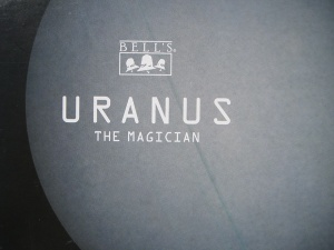 Image of gray uranus on beer box.